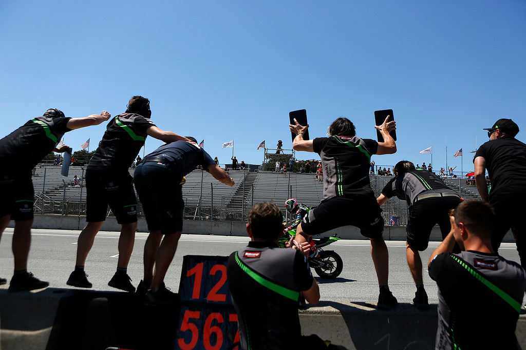 . Kawasaki Racing Team\'s Jonathan Rea of Great Britain is greated by members of his team as he finishes his final lap to win Race 2 of the Superbike World Championship at Laguna Seca Raceway in Monterey on Sunday June 24, 2018. (David Royal/ Herald Correspondent)