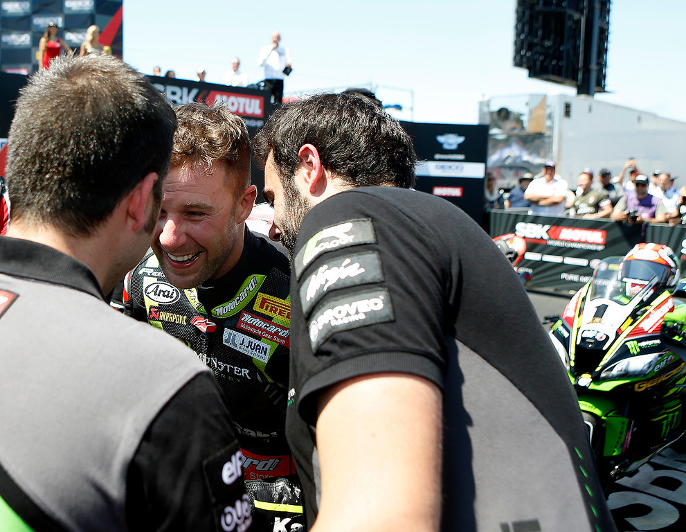 . Kawasaki Racing Teams Jonathan Rea of Great Britain greets members of his team after winning Race 2 of the Superbike World Championship at Laguna Seca Raceway in Monterey on Sunday June 24, 2018. (David Royal/ Herald Correspondent)
