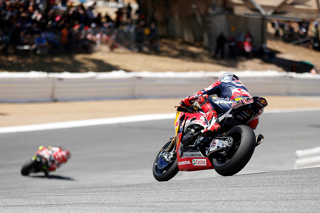 . Racers race down The Corkscrew during Race 2 of the Superbike World Championship at Laguna Seca Raceway in Monterey on Sunday June 24, 2018. Kawasaki Racing Teams Jonathan Rea of Great Britain won the race. (David Royal/ Herald Correspondent)