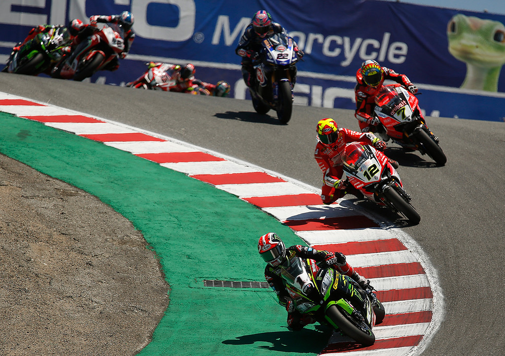 . Kawasaki Racing Teams Jonathan Rea of Great Britain leads a pack of riders into The Corkscrew on his way to winning Race 2 of the Superbike World Championship at Laguna Seca Raceway in Monterey on Sunday June 24, 2018. (David Royal/ Herald Correspondent)