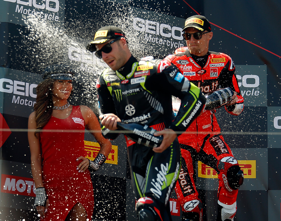 . Ducati team rider Chaz Davies sprays Kawasaki Racing Teams Jonathan Rea of Great Britain with prosecco after Rea won Race 2 of the Superbike World Championship at Laguna Seca Raceway in Monterey on Sunday June 24, 2018. Davies placed second in the race. (David Royal/ Herald Correspondent)
