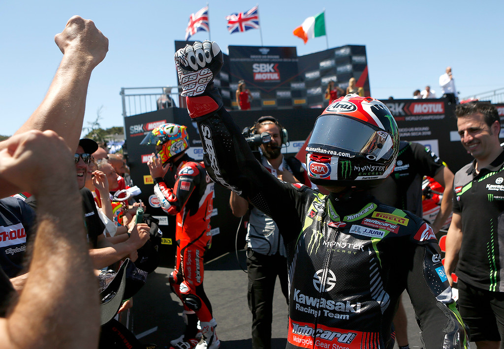 . Kawasaki Racing Team\'s Jonathan Rea of Great Britain greets members of his team after winning Race 2 of the Superbike World Championship at Laguna Seca Raceway in Monterey on Sunday June 24, 2018. (David Royal/ Herald Correspondent)