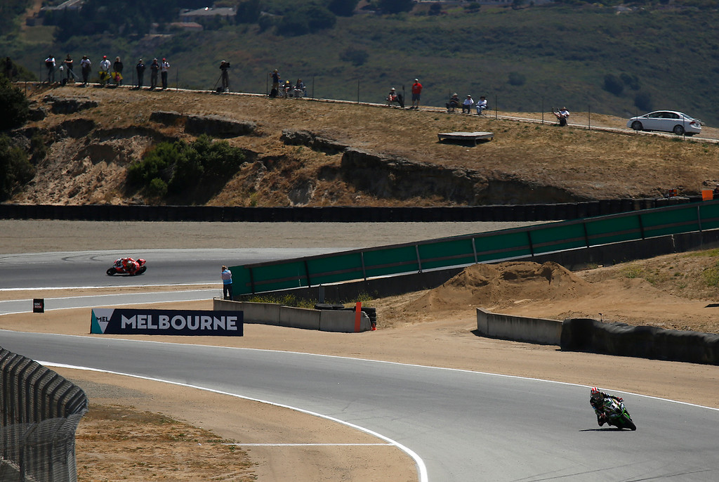 . Kawasaki Racing Teams Jonathan Rea of Great Britain races through turn three on his way to winning Race 2 of the Superbike World Championship at Laguna Seca Raceway in Monterey on Sunday June 24, 2018. (David Royal/ Herald Correspondent)