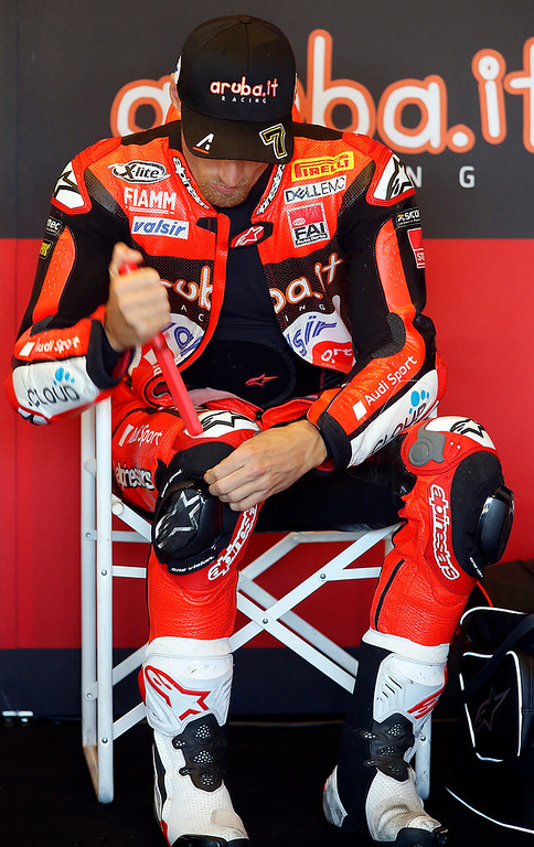 . Ducati team rider Chaz Davies readies pads on his racing suit before Race 2 of the Superbike World Championship at Laguna Seca Raceway in Monterey on Sunday June 24, 2018. Kawasaki Racing Teams Jonathan Rea of Great Britain won the race. Davies finished the race in second place. (David Royal/ Herald Correspondent)