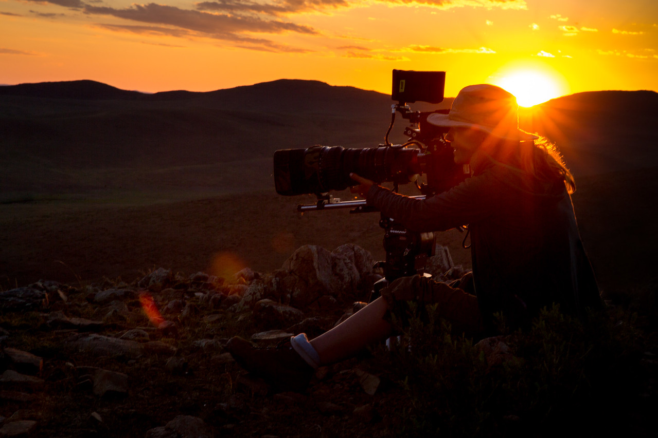 Camerawoman Sue Gibson @smgibbo making the most of another gorgeous Mongolian sunset #Mongolian steppe  #Filming #Sunset #Womeninfilm #Camerawoman #Cinematography #EarthOnLocation #BBCEarth @Paramooutdoor