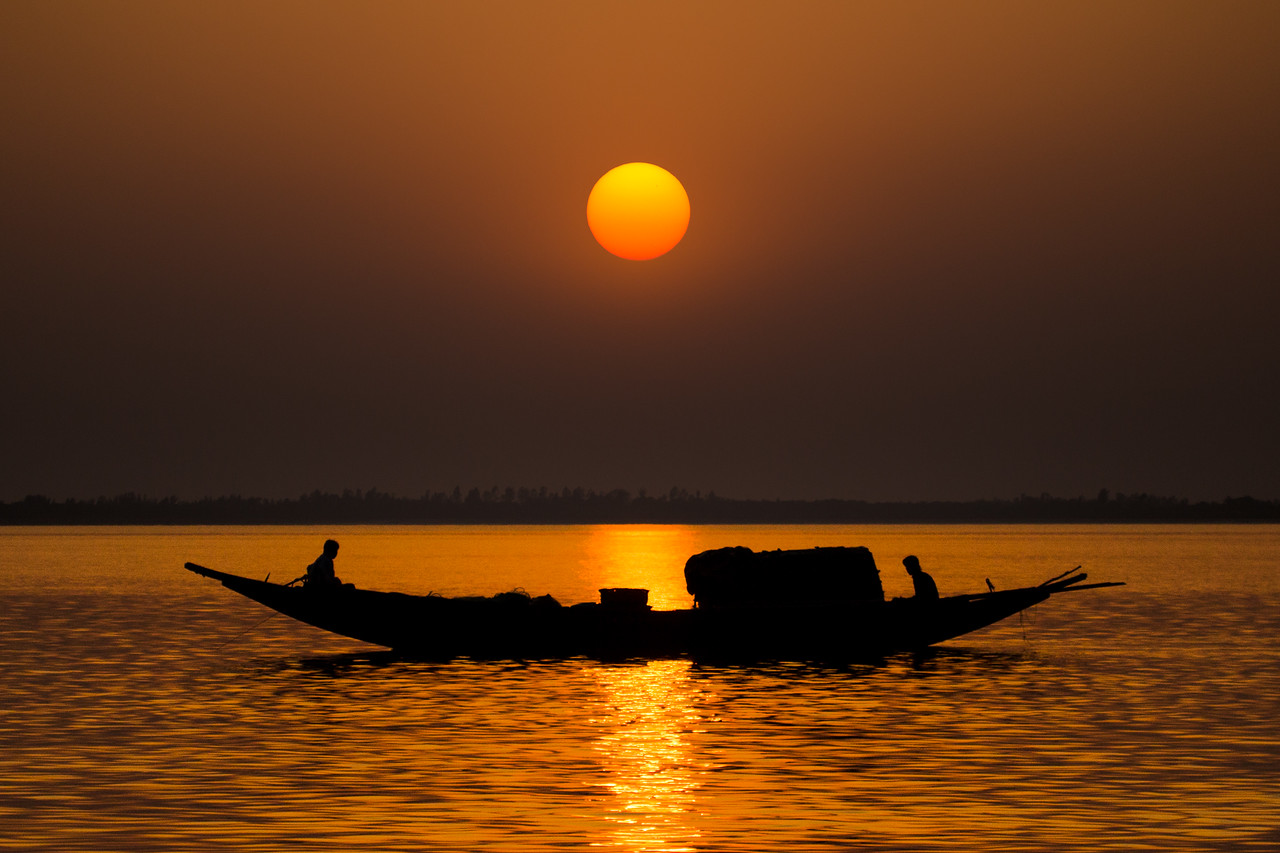 Filming for #BBCEarth #EarthOnLocation in the #Sundarbans, #India... this was my last evening and as I watched the sun turn from egg yolk yellow to a deep crimson red, I knew that the sun would not set. It is a strange thing about the Sundarbans in that each evening the suns transit to the horizon is interupted as it dissapears behind a growing mist. During the night this mist envelops all the islands so that by morning you are greeted by a fog so thick that it can take several hours for the rising sun to show itself again. #Sunrise #Sunset #Fishing #Boat #Mangrove #Fog