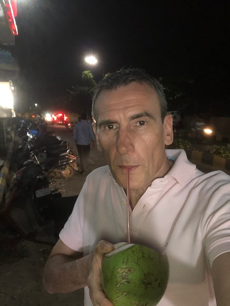 Fresh coconut from a street vendor on an evening walk Electronic City, Bengaluru