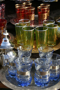 Tea glasses at the souk. A souk (سوق, also sook, souq, or suq) is a commercial quarter in an Arab city.