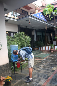 Drinking water from Hotel Holy Himalaya before heading out for a walk around Thamel.