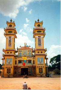 "Cao Dai temple. The term ""Cao Dai"" which means ""high tower or palace"", is used to refer to God. To learn more about that religion:http://www.laze.net/papers/caodai.shtml"