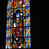 One of many huge stained glass windows inside the Basilica church in Quito