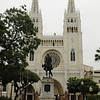 """Parque Bolivar in Guayaquil is also known as """"Iguana Park"""" because of all the Green Tree Iguanas that hang out there.  The monument of Simon Bolivar stands in front of the Catedral Catolica"""