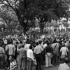 In the Plaza del Centrario (Guayaquil), the guy in the white shirt (in middle of crowd, in front of tree on RHS) was just performing theater. I was sure something cool was going to happen, possibly a death defying juggling act or something....  Nope, just jokes and laughter...
