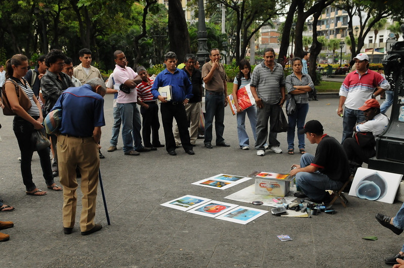 In the Plaza del Centrario (Guayaquil), this guy was doing some of the ame spray-art i saw in Vegas a while back.  Just like Vegas, he drew a nice crowd of spectators