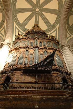 A massive pipe organ inside the cathedral