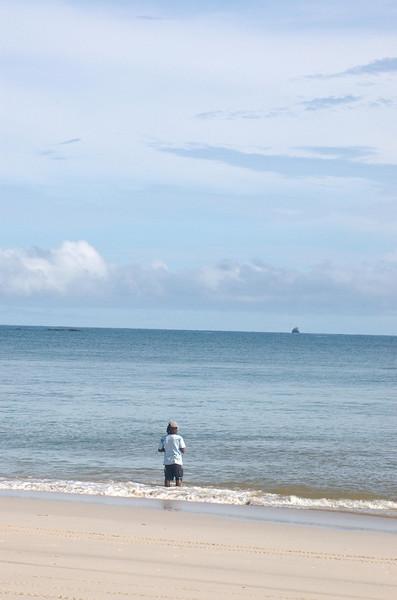 A man fishing on Playa Conchal