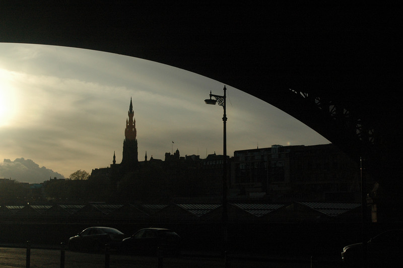 The Scott Monument viewed from under the North Bridge at sunset.