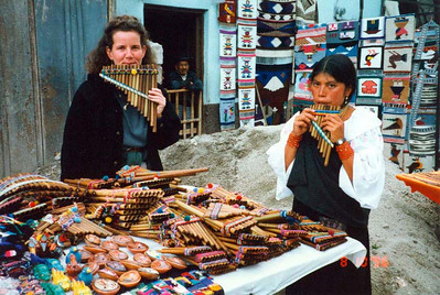 Market in Otavalo (Melanie playing pan flute in 1996)