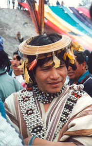 Man from the Amazon Forest (traditional clothing). The rainforest is home to thousands of indigenous inhabitants, who make up nearly 200 distinct nations, including the Siona, Secoya, Cofan, Shuar, Achuar), Zaparo, Huaorani, and Quichua.