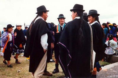 Men from Otavalo in Quito (1996): White shirt, black poncho, short pants, beautiful ponytail and a hat