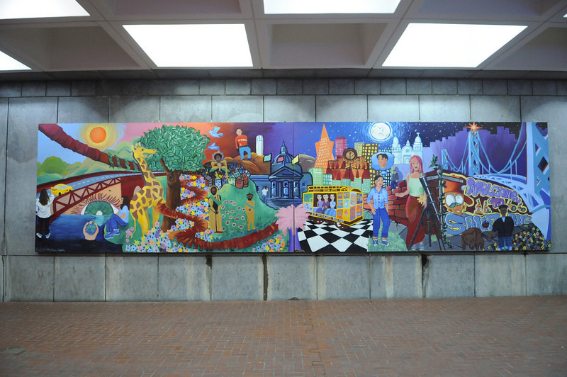 A mural in Hallidie Plaza at the Powell Street Station.  Notice the rat running across the botton in the drainage channel. (Mural by the Meridian Gallery)
