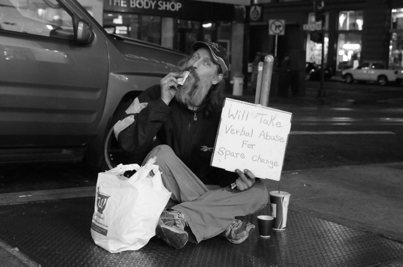 """George, aka """"Popcorn"""", on Powell St.  For the record, he claims that the people who choose to verbally abuse him often don't pay.  He was a really nice guy to talk with for a while."""