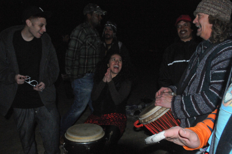 A dancer enjoys taking a moment to try her hands on the drums