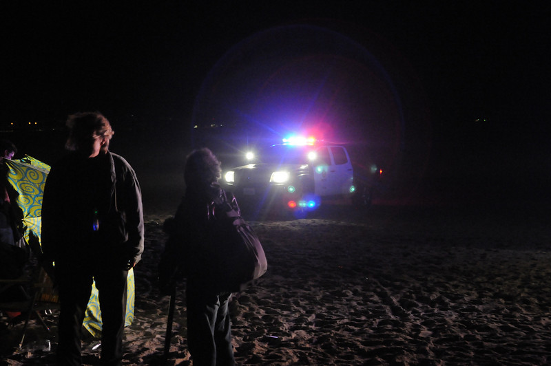 Although the haloe maks them look like Roller Droids (from Episode 3), the party was over when the cops came.  Before I realized it was the cops, I was acutally pretty happy someone parked their car on the beach to provide some light..  Oops