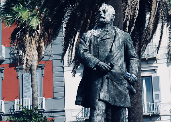 A Statue beneath the Palms