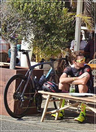 High saddled cyclist takes a break