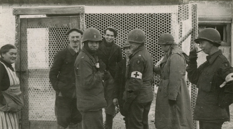 Lt. Golson, Capt Bordelon, Capt Mechan and Maj Whitlock try out their French on a family near Selles, France.