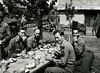 Rodgers, Lorenco, Roland and Bumbico<br /> eat in open air mess hall at<br /> Saaldorf