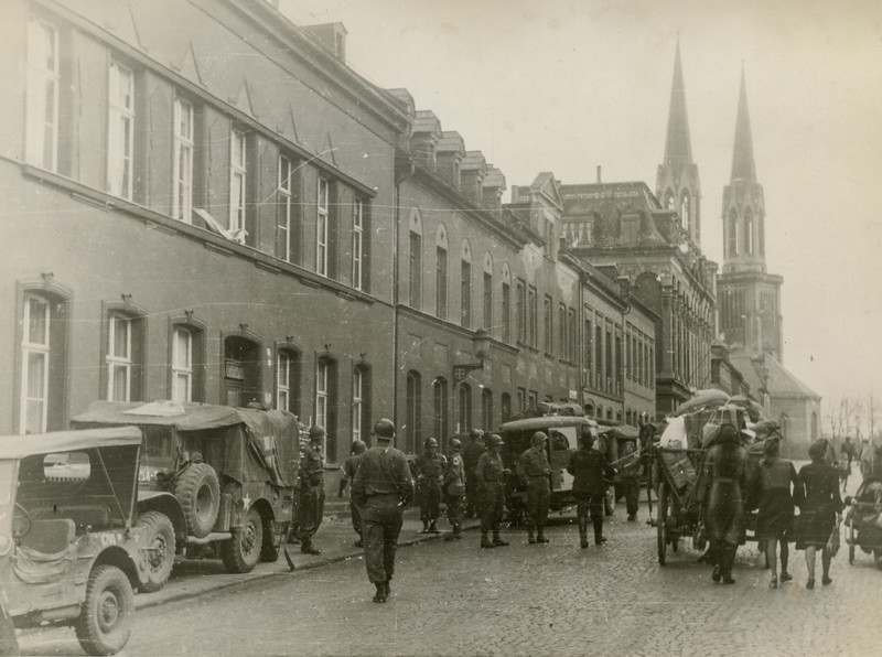 The station at Oelnitz, Germany showing the natives moving their belongings through the<br /> street., Germany showing the natives moving their belongings through the<br /> street.