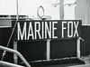 The Marine Fox nameplate. Notice that it is on hinges so it can be lowered from view.
