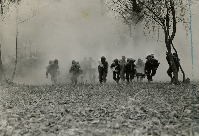 Training at Camp McCain - Evacuation of wounded during gas attack.
