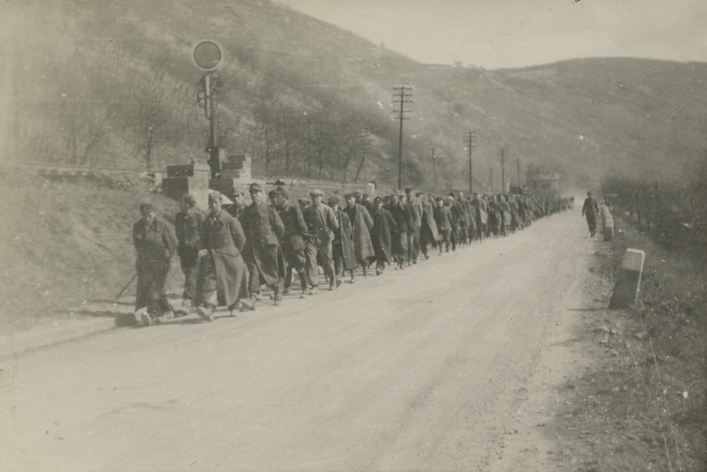 A group of prisoners marching up the road.<br /> [Censored Reist]
