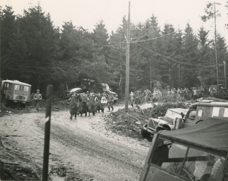 German PW's taken in the Siegfred line are marched past Company A's station near Auw, Germany