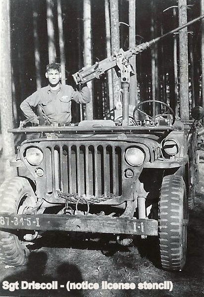 Vedder Driscoll in US jeep with flack gun