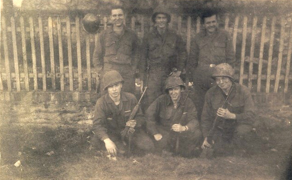 Along the Rhine River, prior to crossing. George Bryant, who is on the top right in this photo, indicated that it was dangerous to go behind this house, due to German snipers.