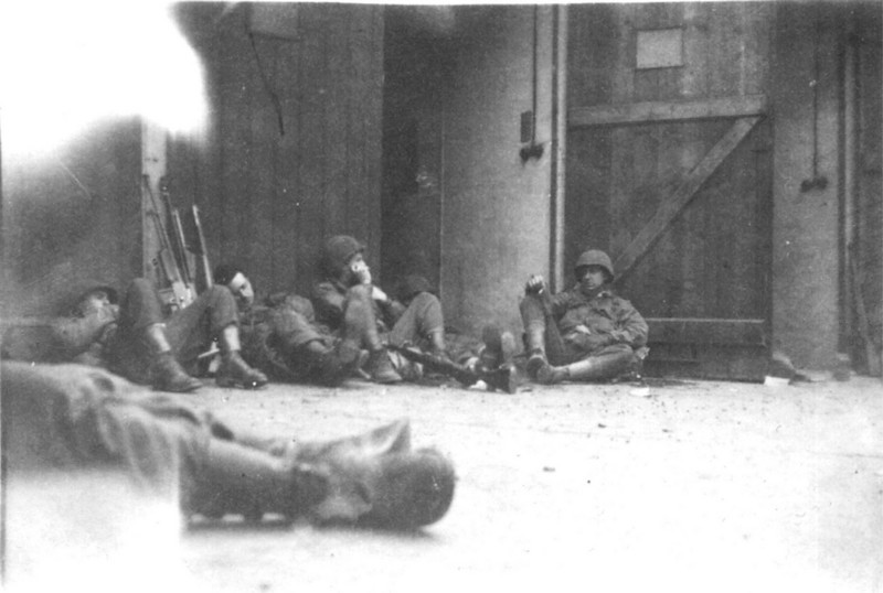 Resting after a fight.  Left to right: William Watson, Sheridan Stein, George Wilcox, Donald Campbell.