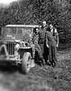 "F Company's artillery forward obervation team at the end of the war.  Left to right: Homer Hockmiller (jeep driver), Ted Anderson, Albert Tucker.  Words on jeep read, ""Homer the Roamer."""