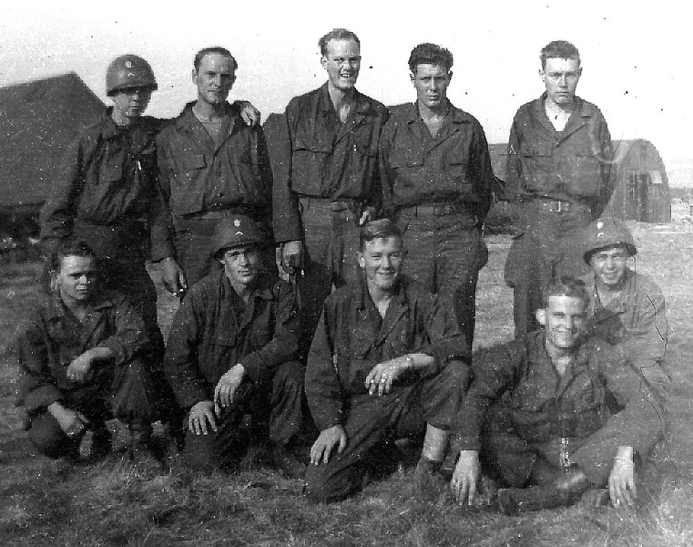 France - 1945.  F Company waiting to go home.  Left to right (front row):  Richard Pearce, Marvin Winkles, Troy Farmer, Harold Wick; (back row):  Delton Groothuis, Kromfeld, Fred Amondsen, Leonard Fendrick, Smith.