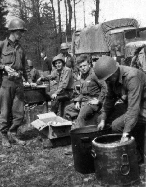 Joe Merrick and Shorty serving hot chow to F Company.