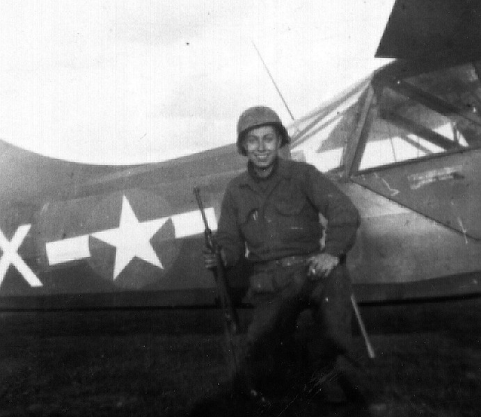Jules Korn standing in front of an artillery observation plane.