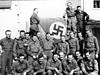 Nazi flag captured in Koblenz, Germany by the 87th Division.  William Parod is holding the left lower corner of the flag (second row, fifth from left).