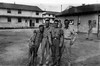 Fort Jackson - 1944<br /> Fred Carmichael second from right; Sgt. Jenson on right.  Two-story barracks on left; orderly/supply room on right.