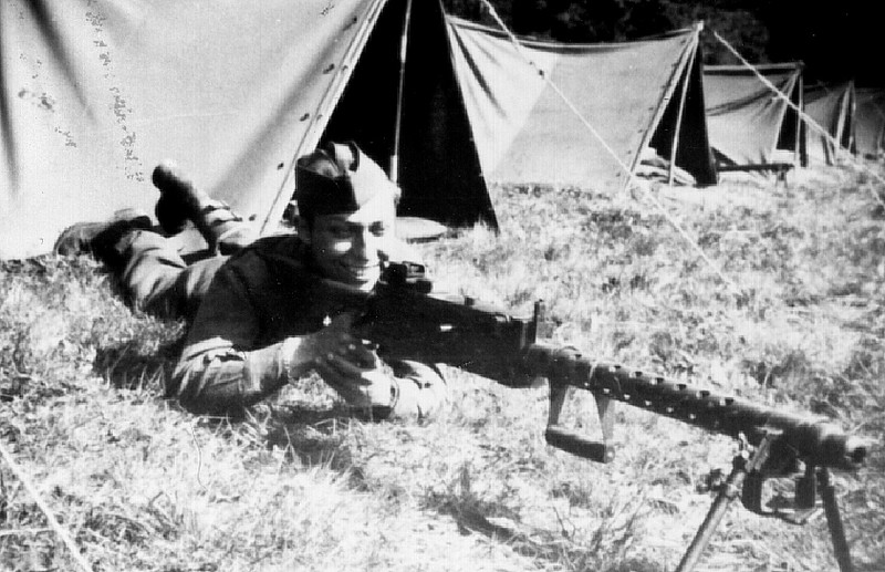 Jules Korn with F Company's 30-calliber light machine gun, A6.
