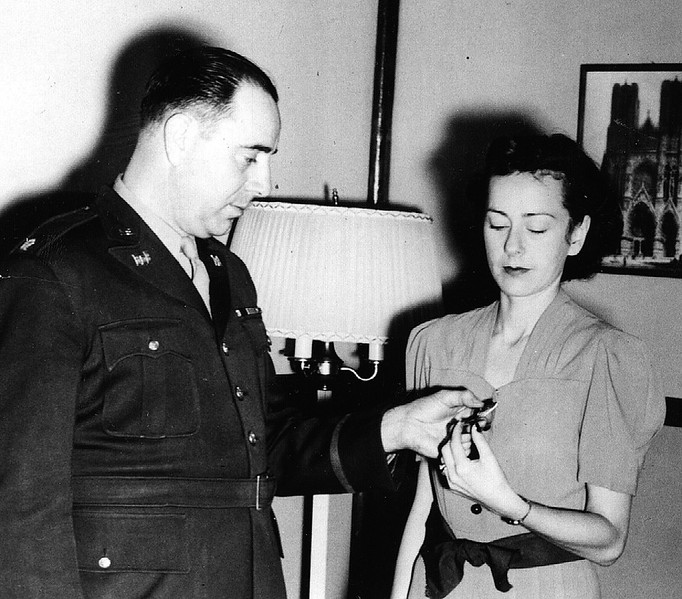 Mrs. Jean Dahlke receives the Bronze Star awarded to her husband, posthumously.
