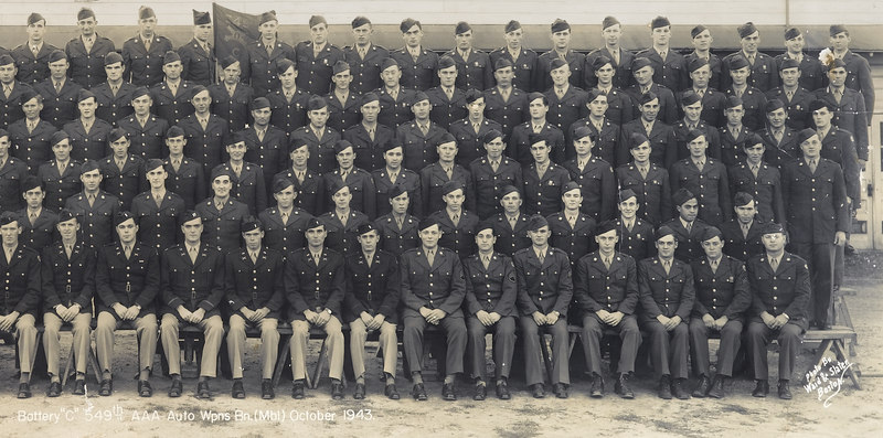 """549th AAA AW BN BTRY C - partial group pic<br /> <br /> Picture dated - October - 1943<br /> <br /> Looking at pic - this is right half of large group pic in this gallery.<br /> <br /> 549th AAA AW BN BTRY C<br /> 87th Infantry Division.<br /> Involved in the Battle Of The Bulge - WWII.<br /> <br /> 87th Infantry Division Association<br /> <a href=""""http://www.87thinfantrydivision.com"""">http://www.87thinfantrydivision.com</a><br /> <br /> Please make contact if you are connected in any way to any of these names shown in this gallery of names under this picture! <br /> <br /> Photo contributed by Tim Muilenburg, <br /> son of Ivan Muilenburg, who served in the 549th."""