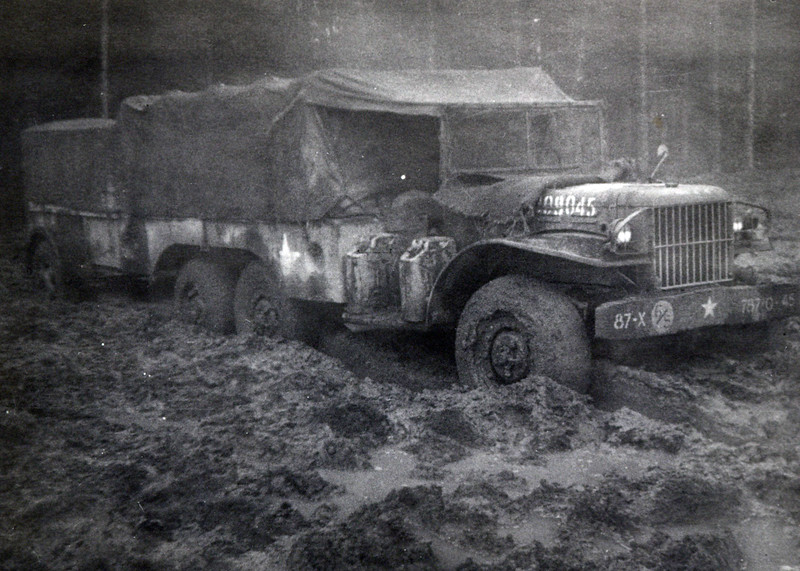 That's my truck & trailer stuck in the mud east of St Vith in March, '45.  The mud is the reason the Division & 3rd Army didn't advance and were in this one area for a month.